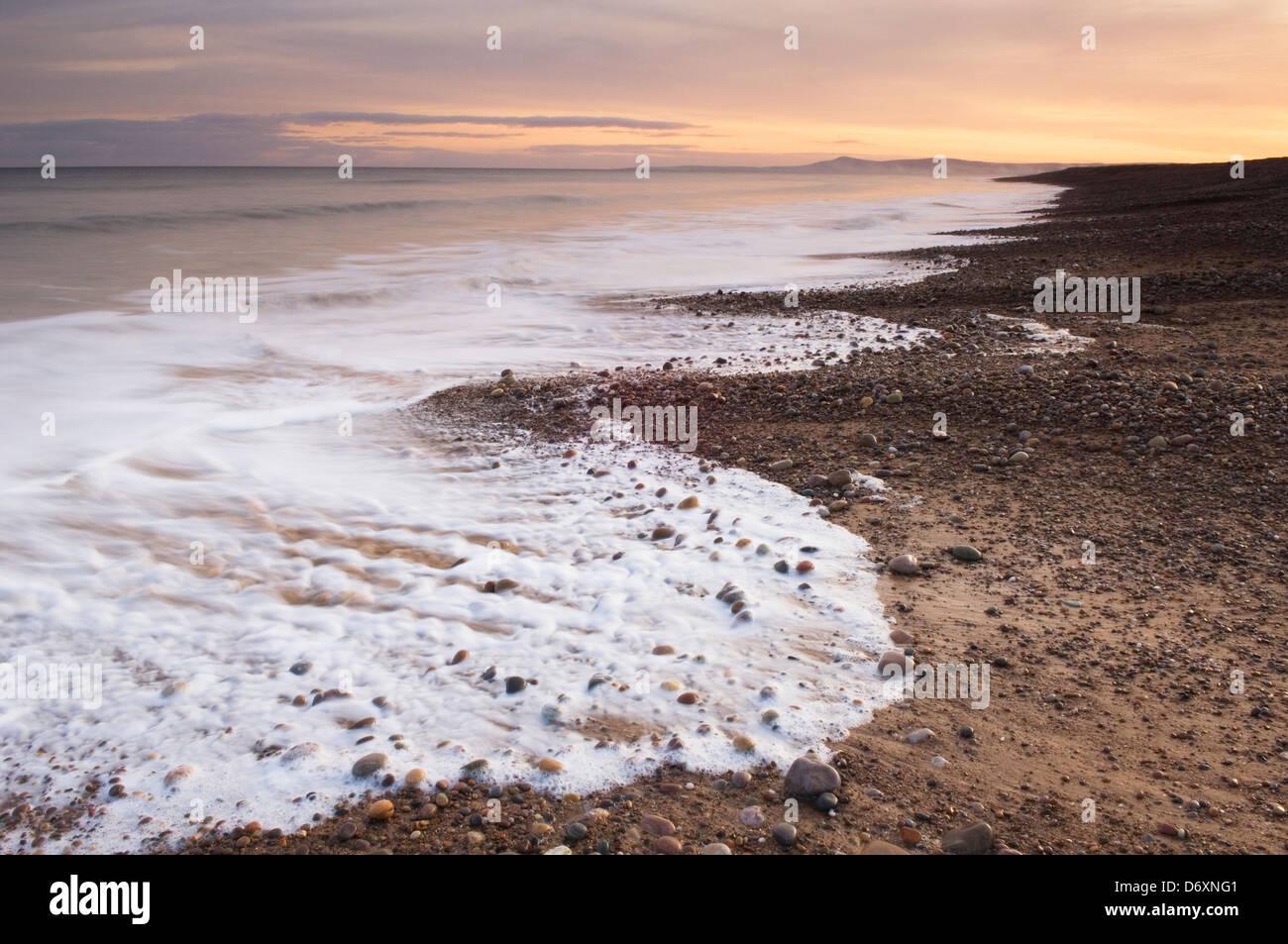 Dawn over Lossiemouth Beach, Moray, Scotland. - Stock Image