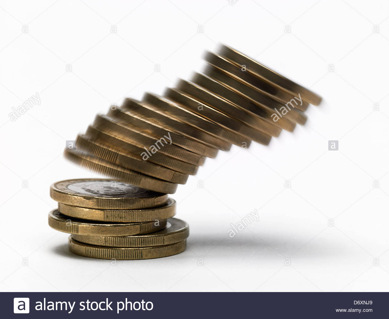 stack of falling one euro coins - Stock Image