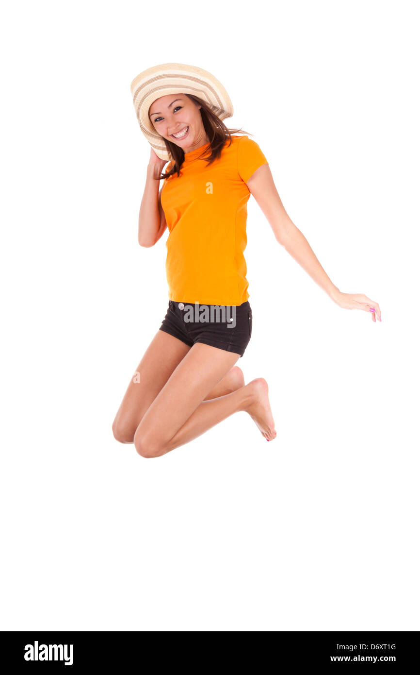 Young beautiful asian woman jumping of joy, isolated on white background - Asian people - Stock Image