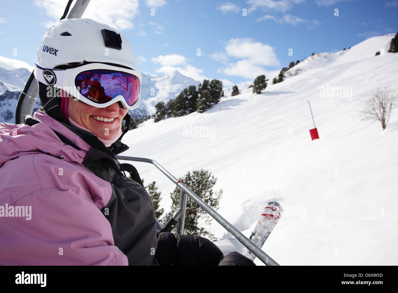 Smiling girl on a chairlift. Skiing in Meribel, France - Stock Image