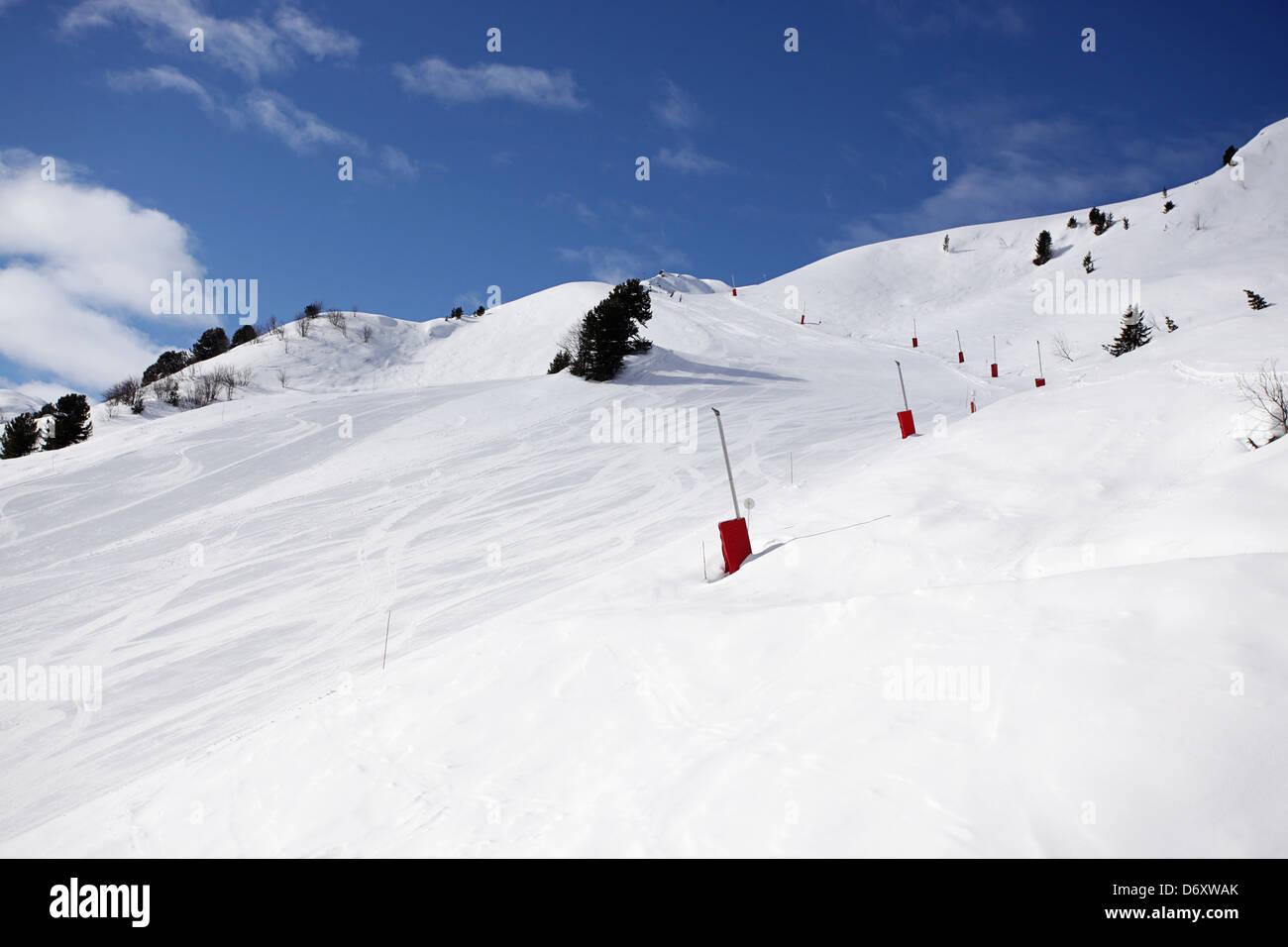 A lovely ski run early morning with freshly pisted snow and clear blue skies. Skiing in Meribel, France - Stock Image