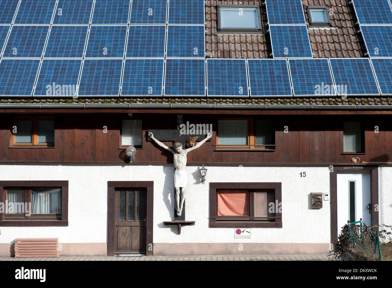Kirchzarten, Germany, an old crucifix on a house with a modern solar system Stock Photo