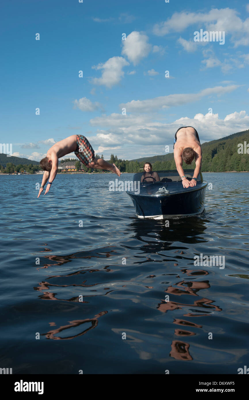 Titisee-Neustadt, Germany, young people take a header of an electric boat in Titisee - Stock Image