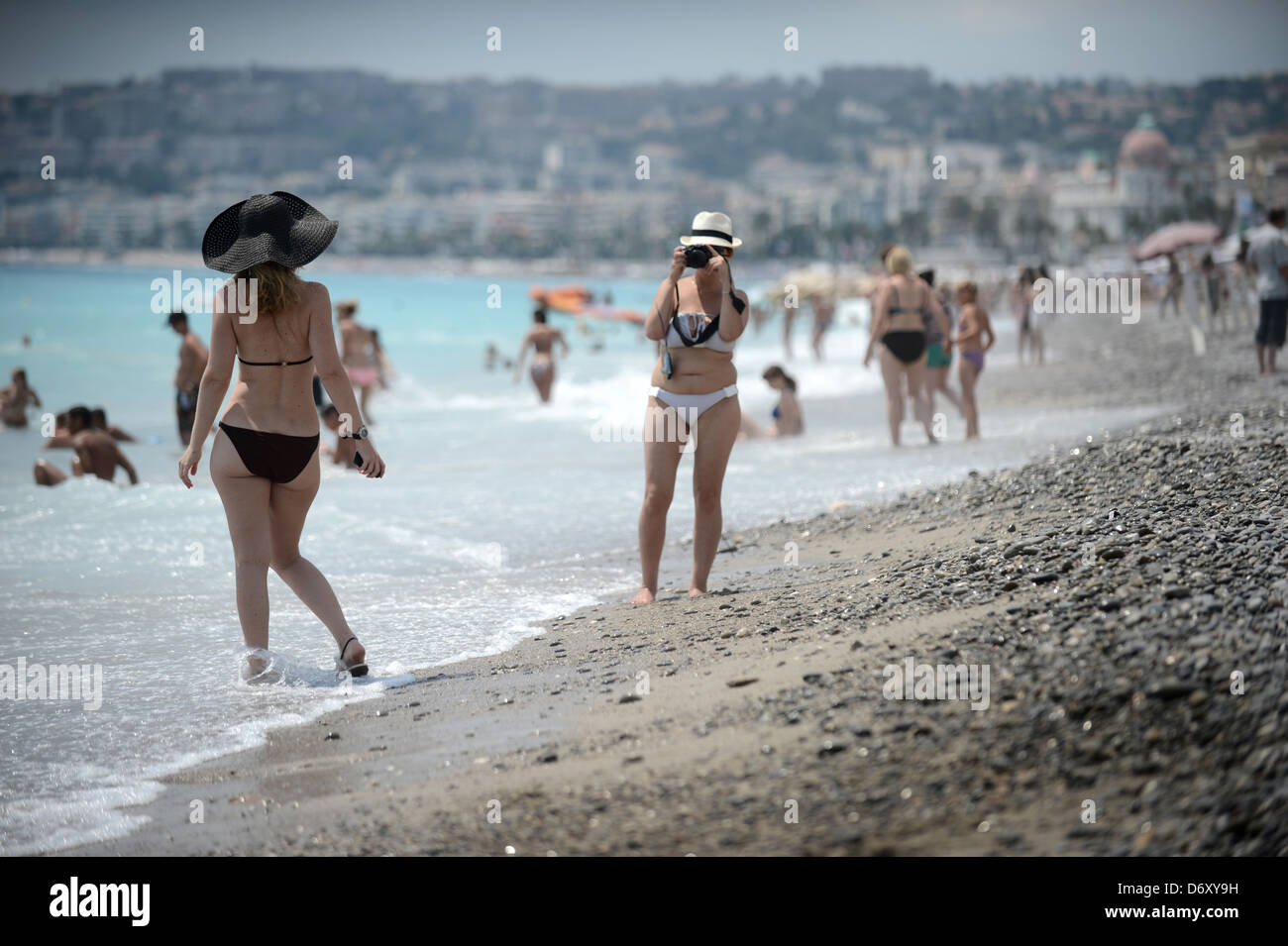 Nice, France, holidaymakers photographed the city beach of Nice - Stock Image