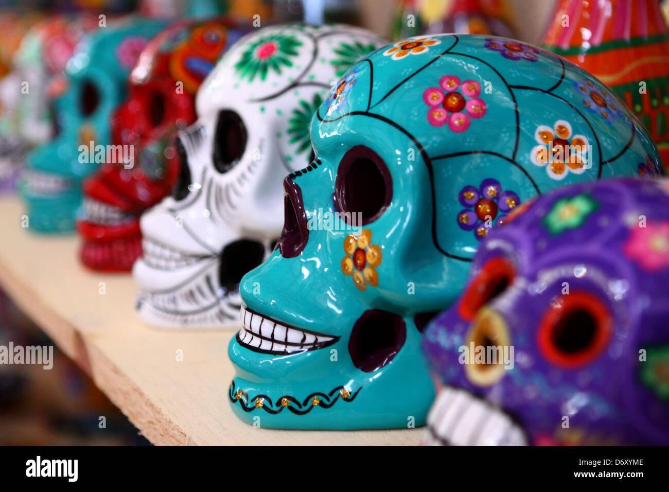 Colourful Mayan ceramic skulls - Stock Image