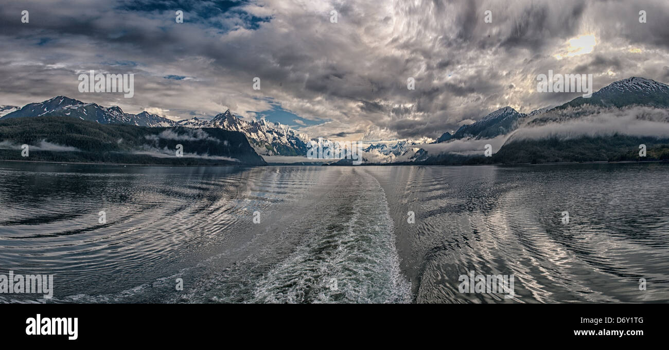 A panoramic image cruise ship wake on the inside passage near Glacier Bay  Alaska - Stock Image