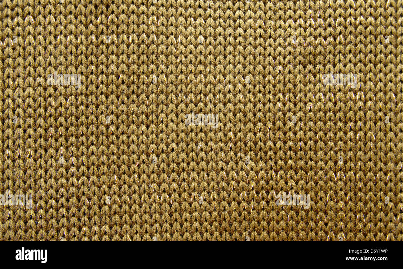 Knitted wool texture, khaki color, close up - Stock Image