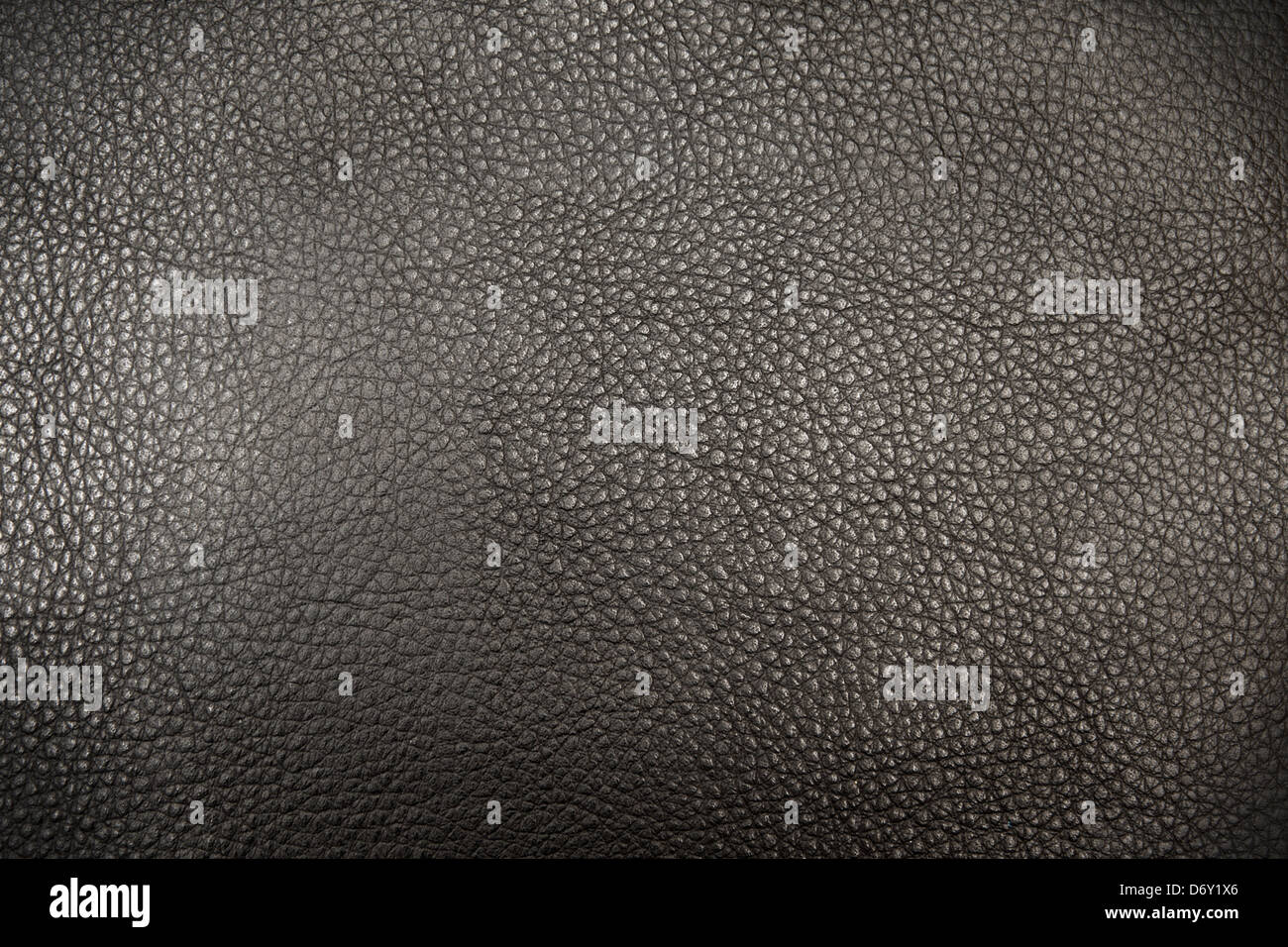 Black genuine natural leather (skin) texture (background) - Stock Image