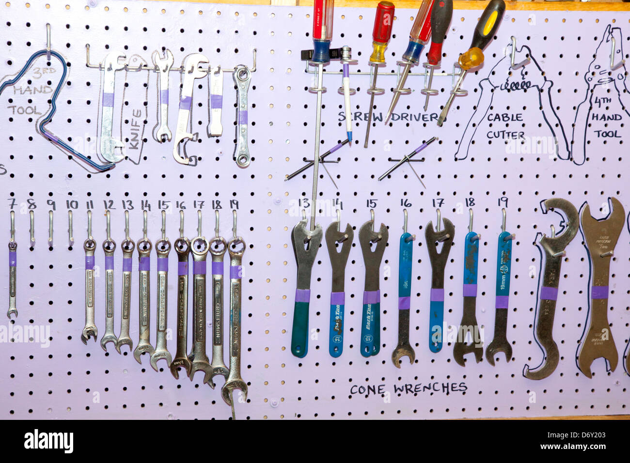 Pegboard tool rack of wrenches and screwdrivers at Youth Express bike repair shop. St Paul Minnesota MN USA - Stock Image