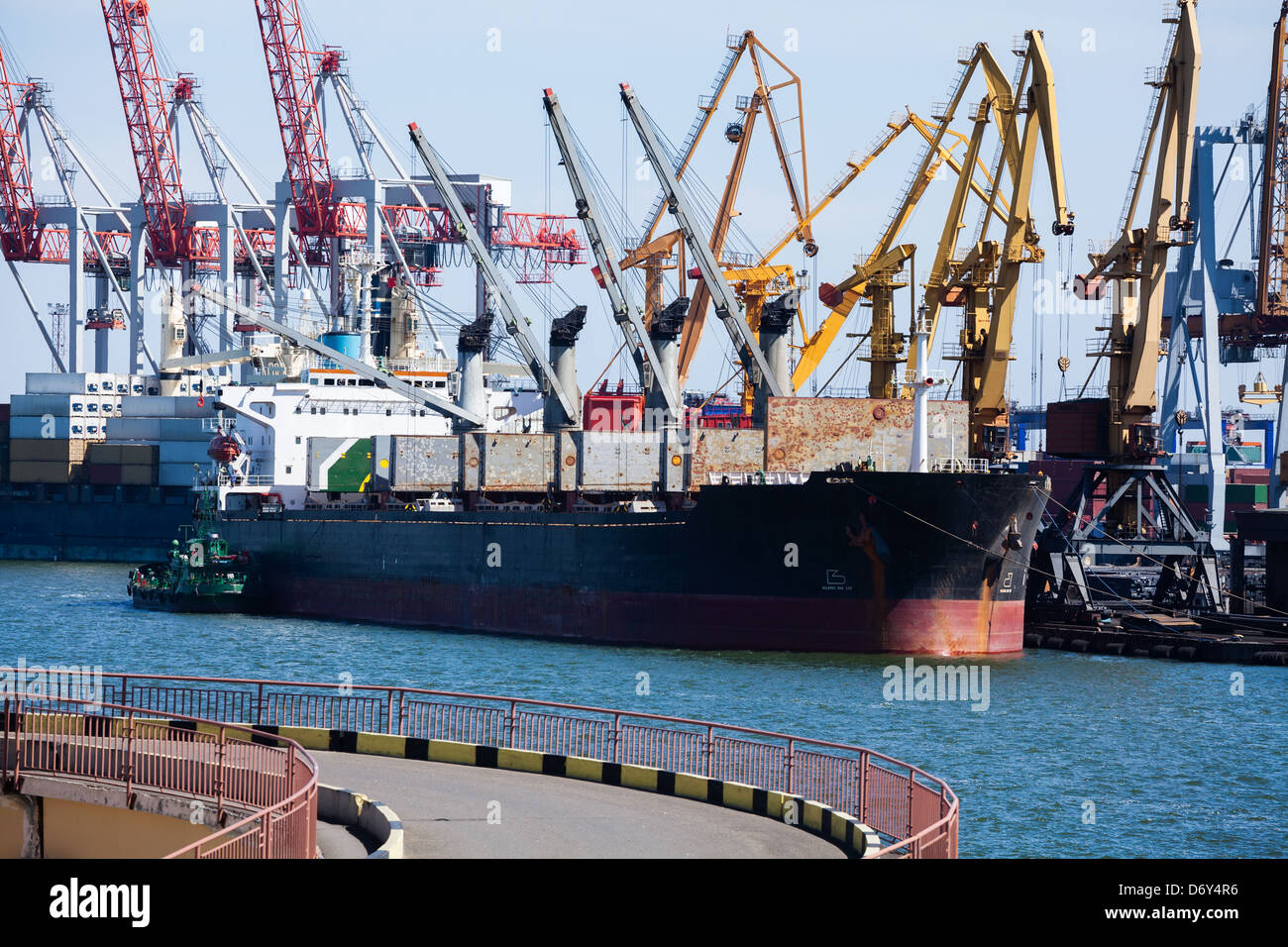 bulk carrier lids open moored - Stock Image