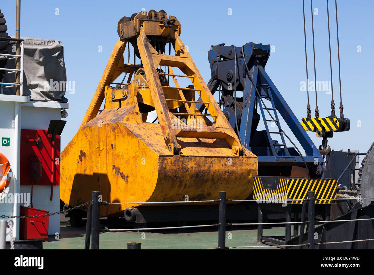 industrial buckets barge aboard used - Stock Image
