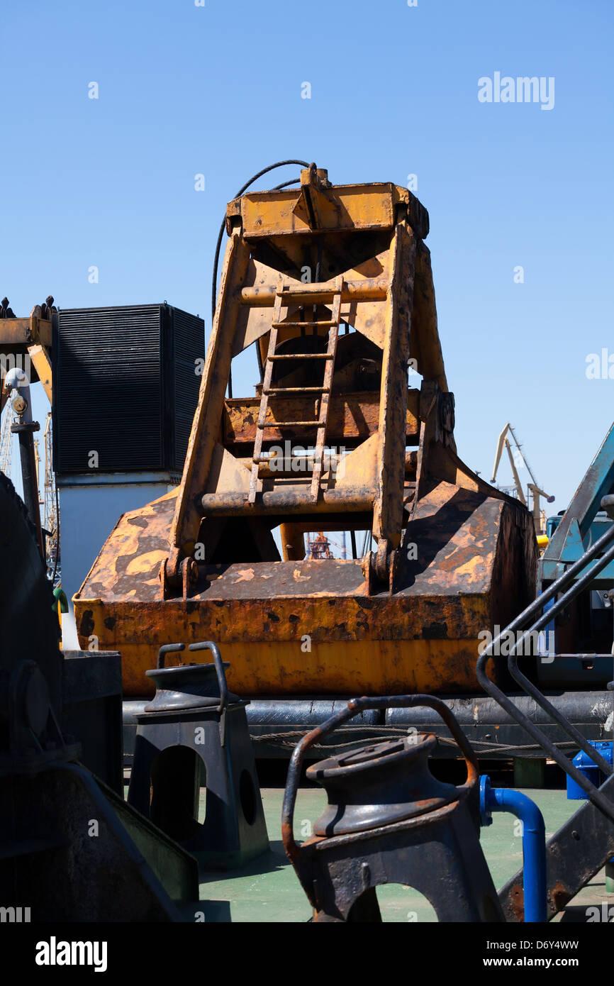 industrial bucket barge aboard used - Stock Image