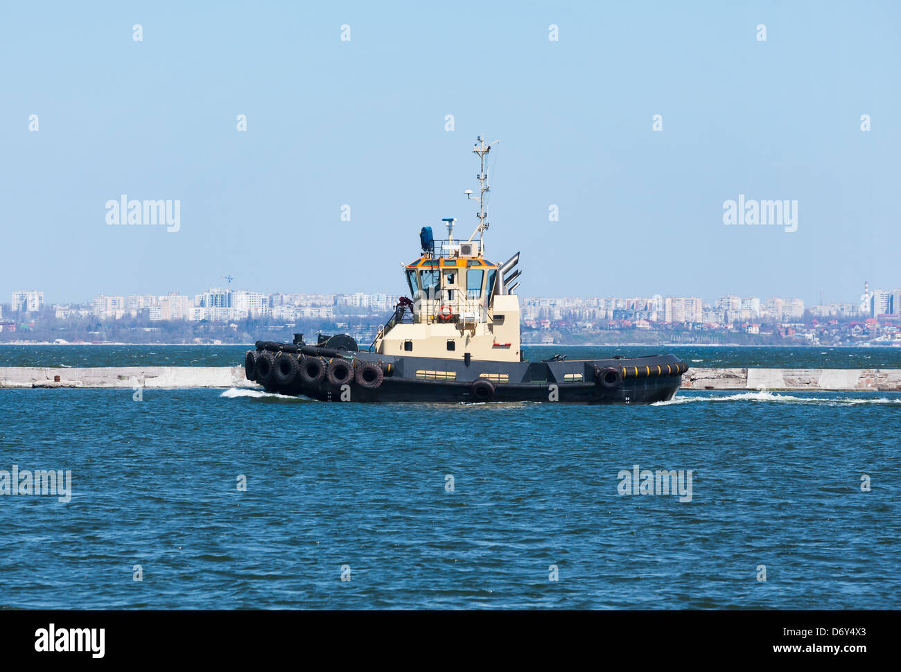 tug boat side view moving - Stock Image