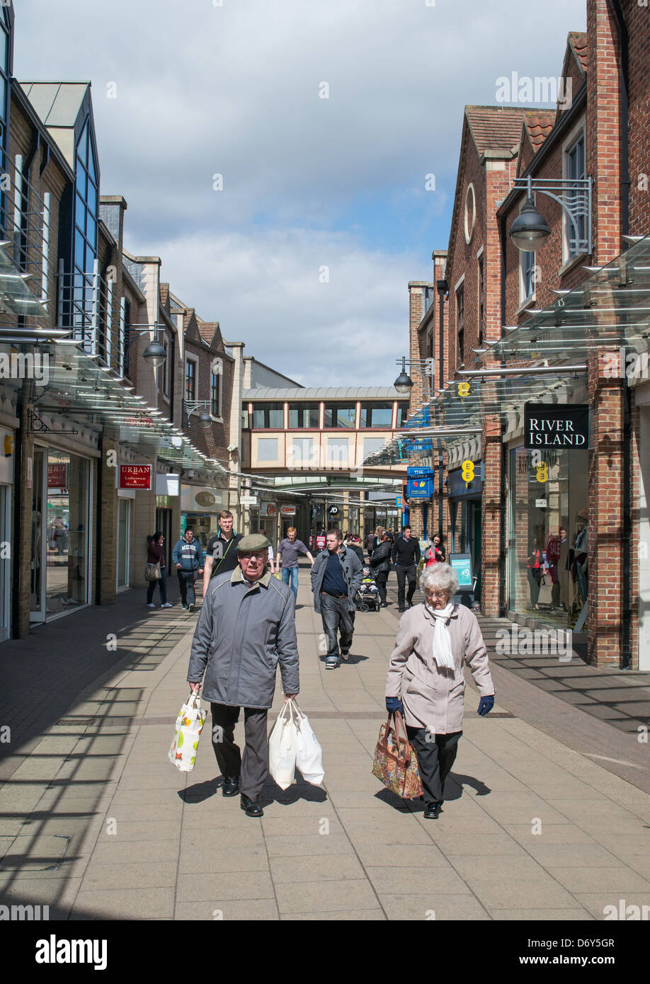 Elderly couple with shopping Stockton-on-Tees town centre north east England UK Stock Photo