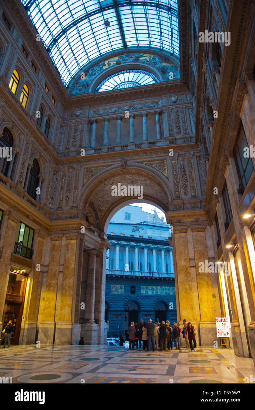 Tourist group inside Galleria Umberto I (1900) shopping arcade central Naples city La Campania region southern Italy - Stock Image