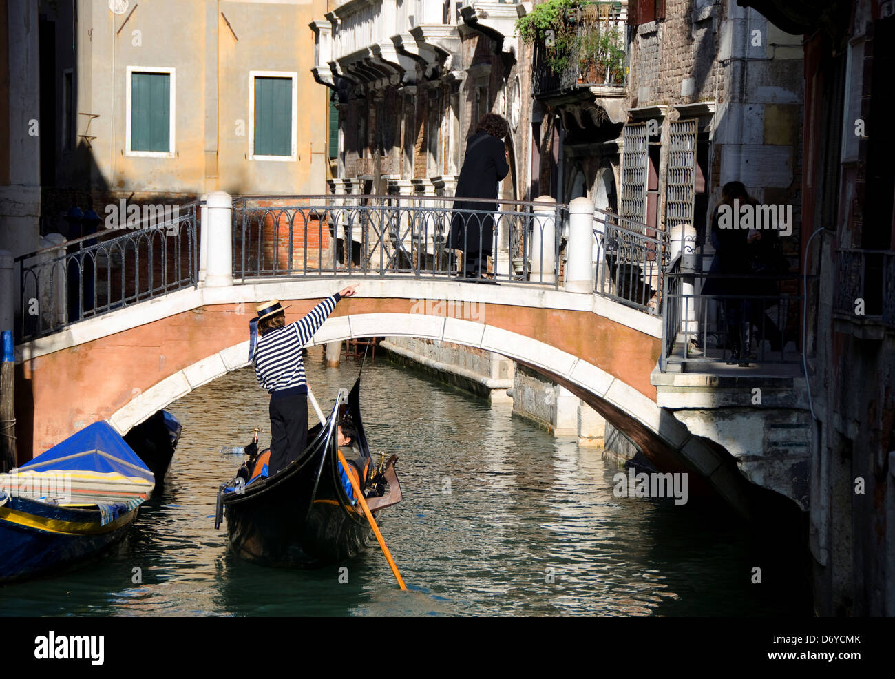 Gondolier pointing to a building where Vivaldi once resided, Grand Canal, Venice, Veneto, Italy - Stock Image