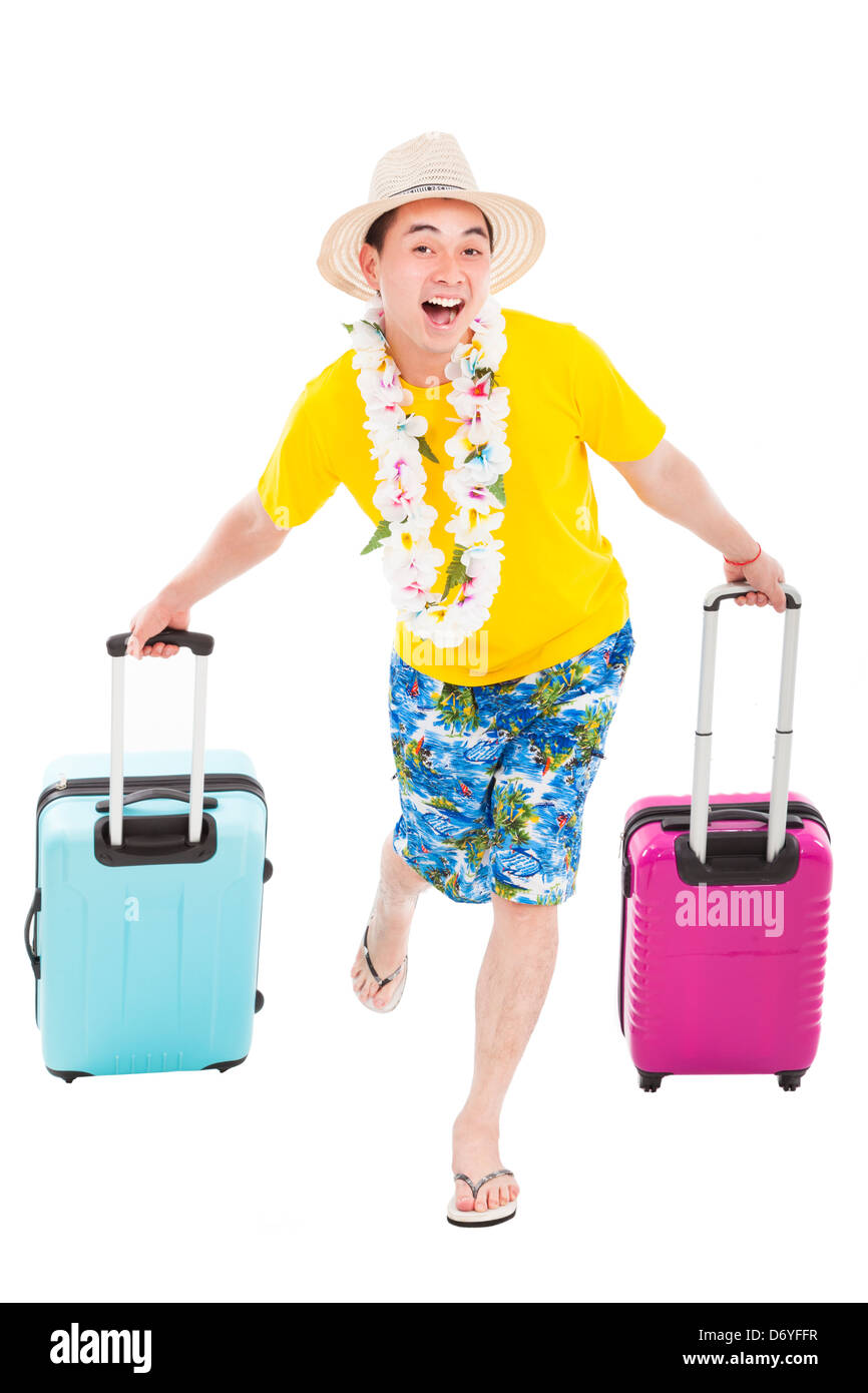 young man enjoy summer vacation with travel suitcase - Stock Image