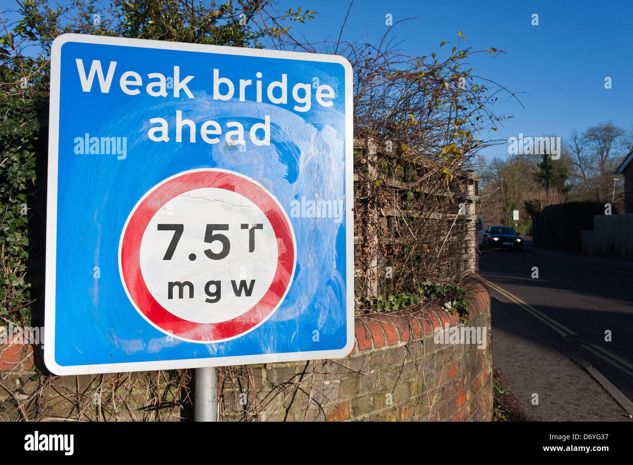 Sign warning of a weak bridge ahead with a weight limit imposed. - Stock Image
