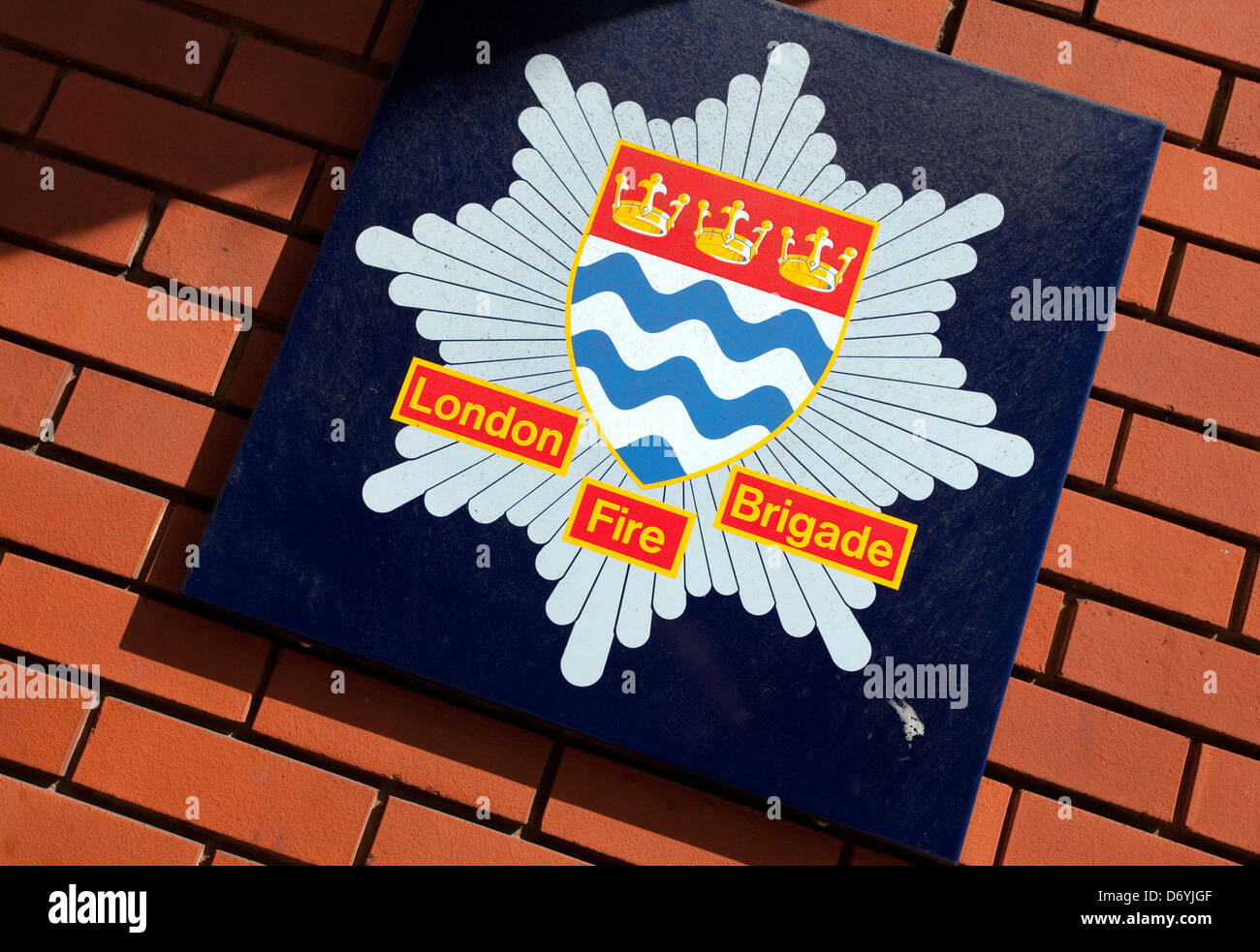 London Fire Brigade crest on fire station, London - Stock Image