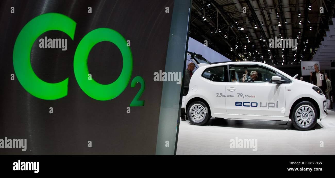 A Volkswagen Up stands next to the lettering 'C02' during the VW general meeting in Hanover, Germany, 25 April 2013. Stock Photo