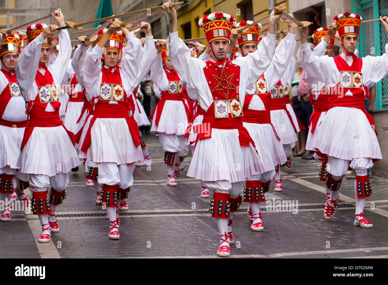 Dancers parading in procession through the streets during San Fermin Fiesta at Pamplona, Navarre, Northern Spain Stock Photo