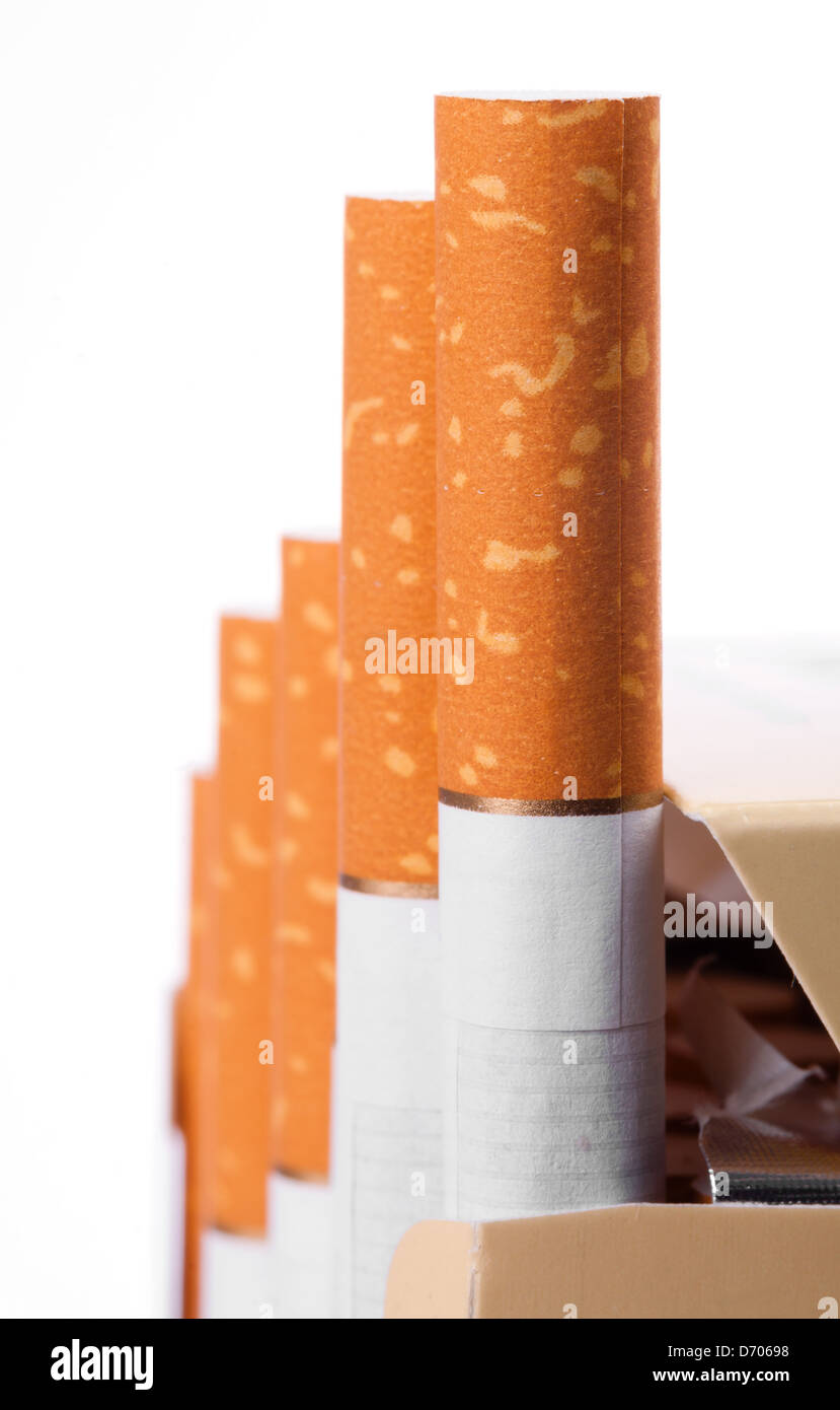 Cigarettes with a brown filter in the box close up - Stock Image