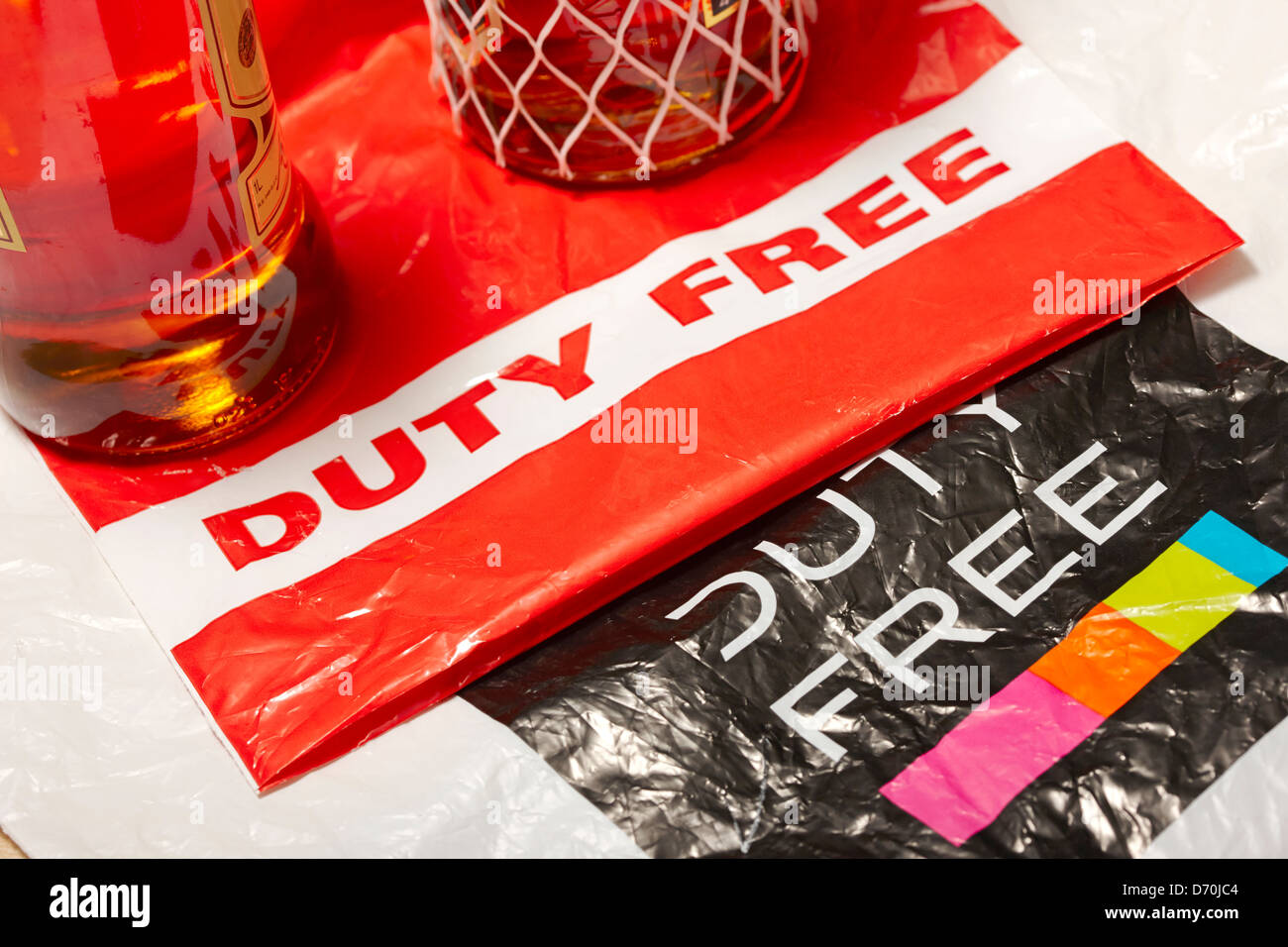 duty free bags with bottles of spirits - Stock Image