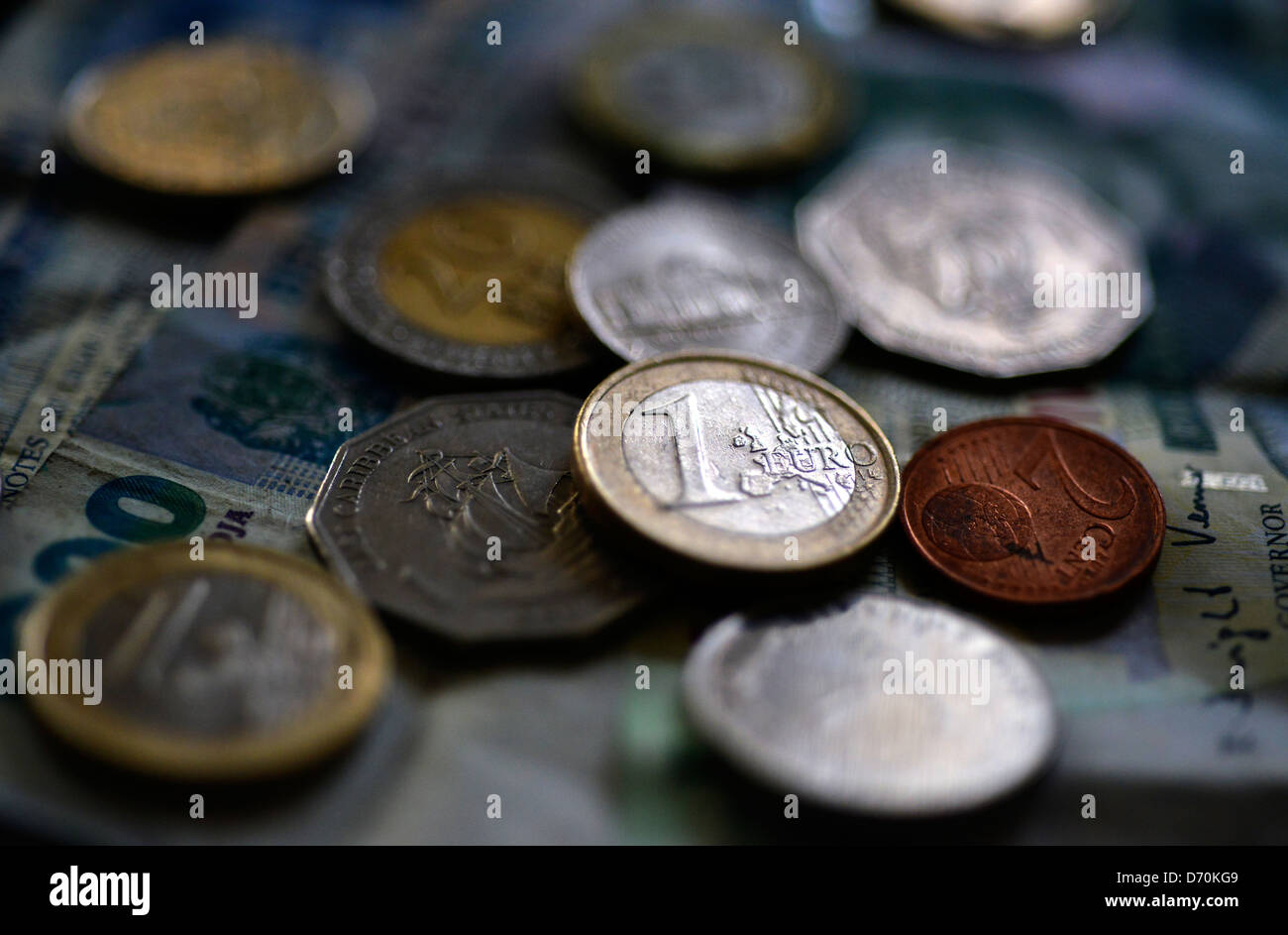 A selection of international currency coins and notes. Stock Photo