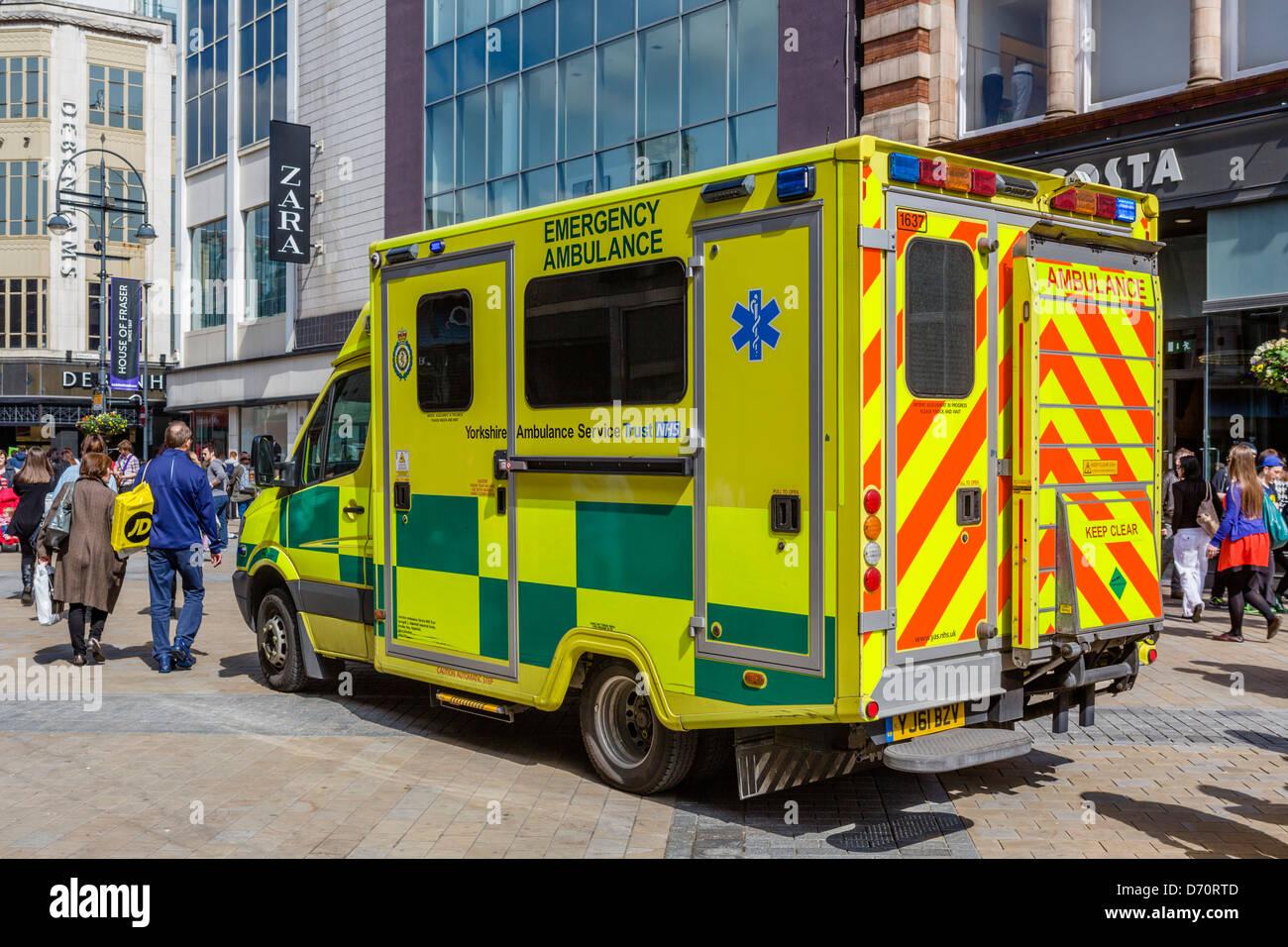Yorkshire Ambulance Service ambulance on Briggate in the city centre, Leeds, West Yorkshire, UK - Stock Image