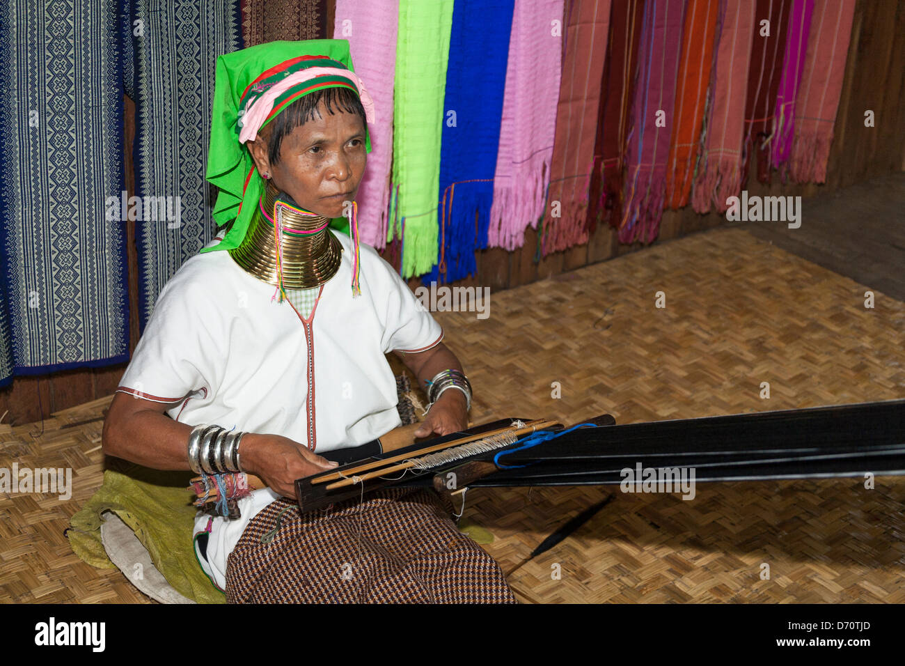 Woman with long neck from the Padaung tribe weaving, Ywama village, Inle Lake, Shan State, Myanmar, (Burma) Stock Photo