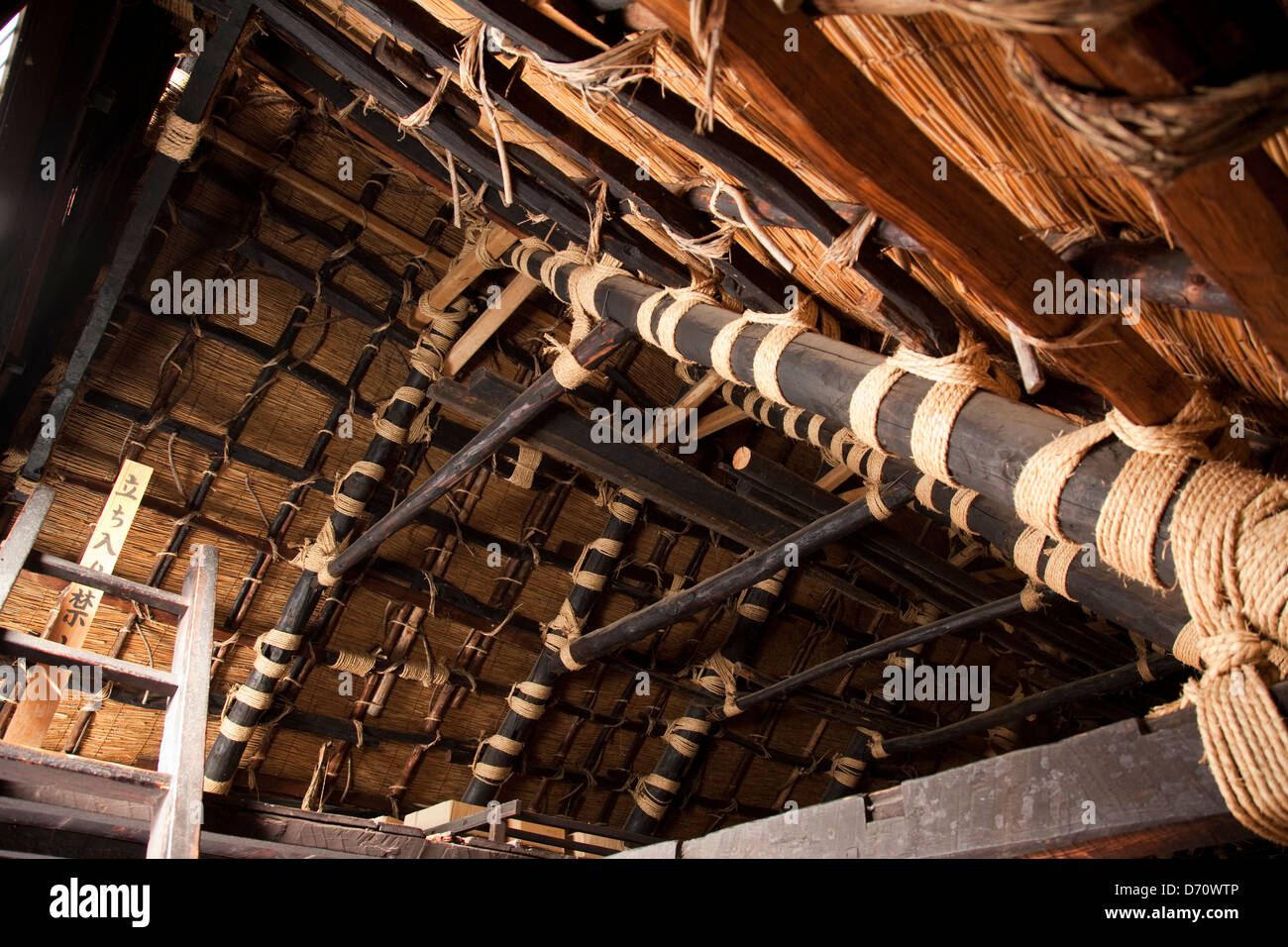 Interior of the steep, thatched roof of a Gassho house in the UNESCO village of Shirakawa-go, Japan. - Stock Image