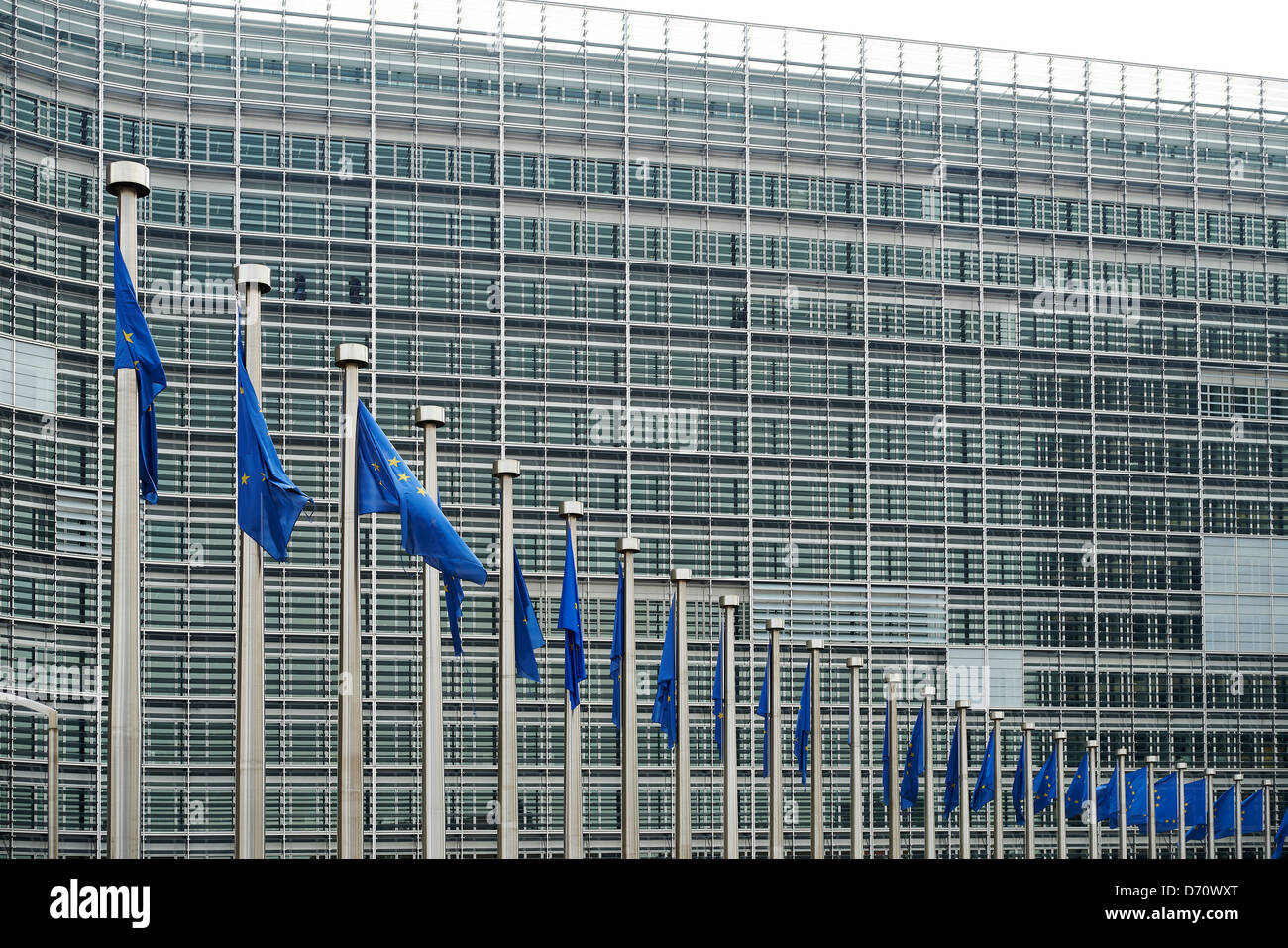 European flags in front of the Berlaymont building, headquarters of the European commission in Brussels. - Stock Image