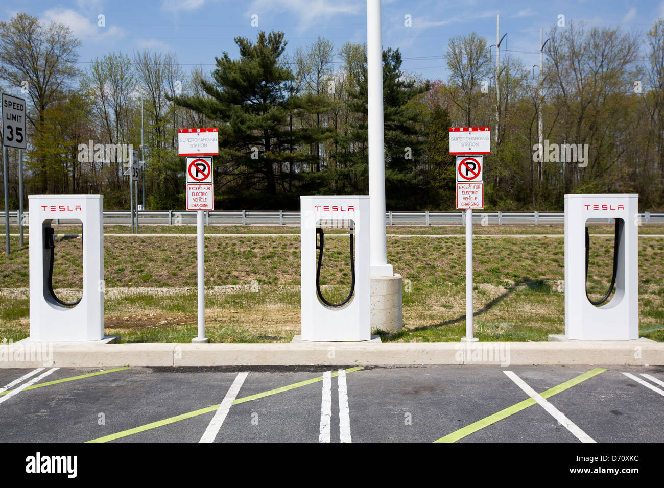 A Tesla electric vehicle Supercharging Station along Interstate 95 in Delaware.  - Stock Image