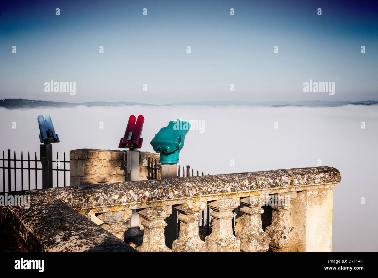 Coin operated binoculars looking out over the cloud filled Dordogne Valley at the medieval bastide of Domme, - Stock Image