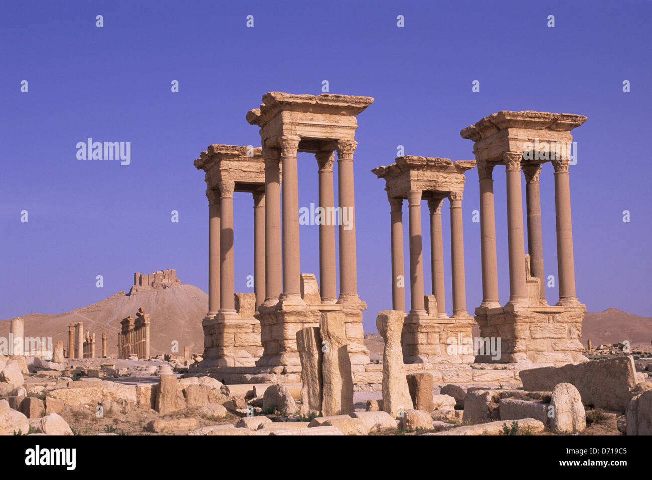 Syria, Palmyra, Ancient Roman City, Tetrapylon And Castle Of Fakhr Ud-Din - Stock Image
