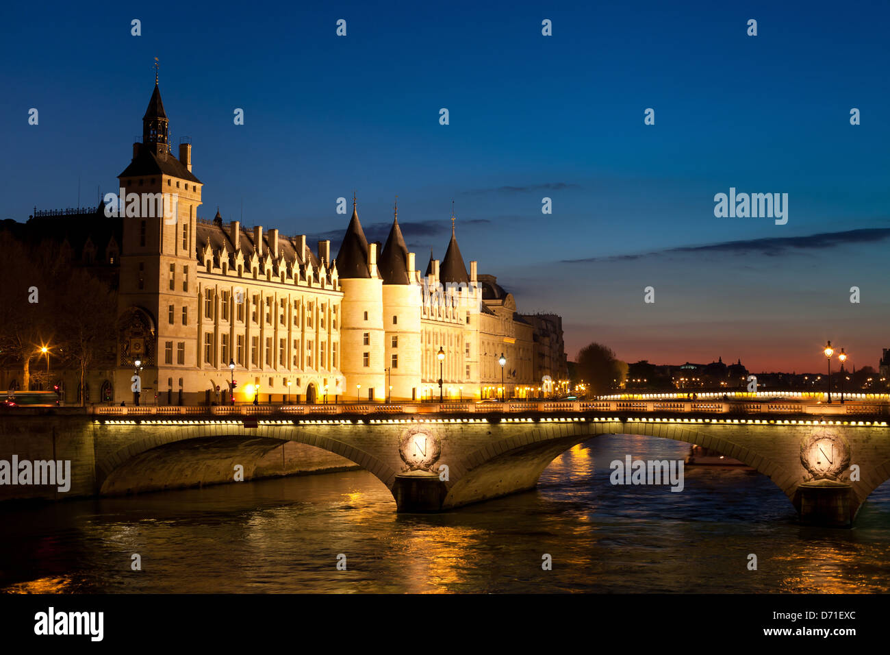 The Pont au Change, bridge over river Seine and the Conciergerie, a former royal palace and prison in Paris, France - Stock Image