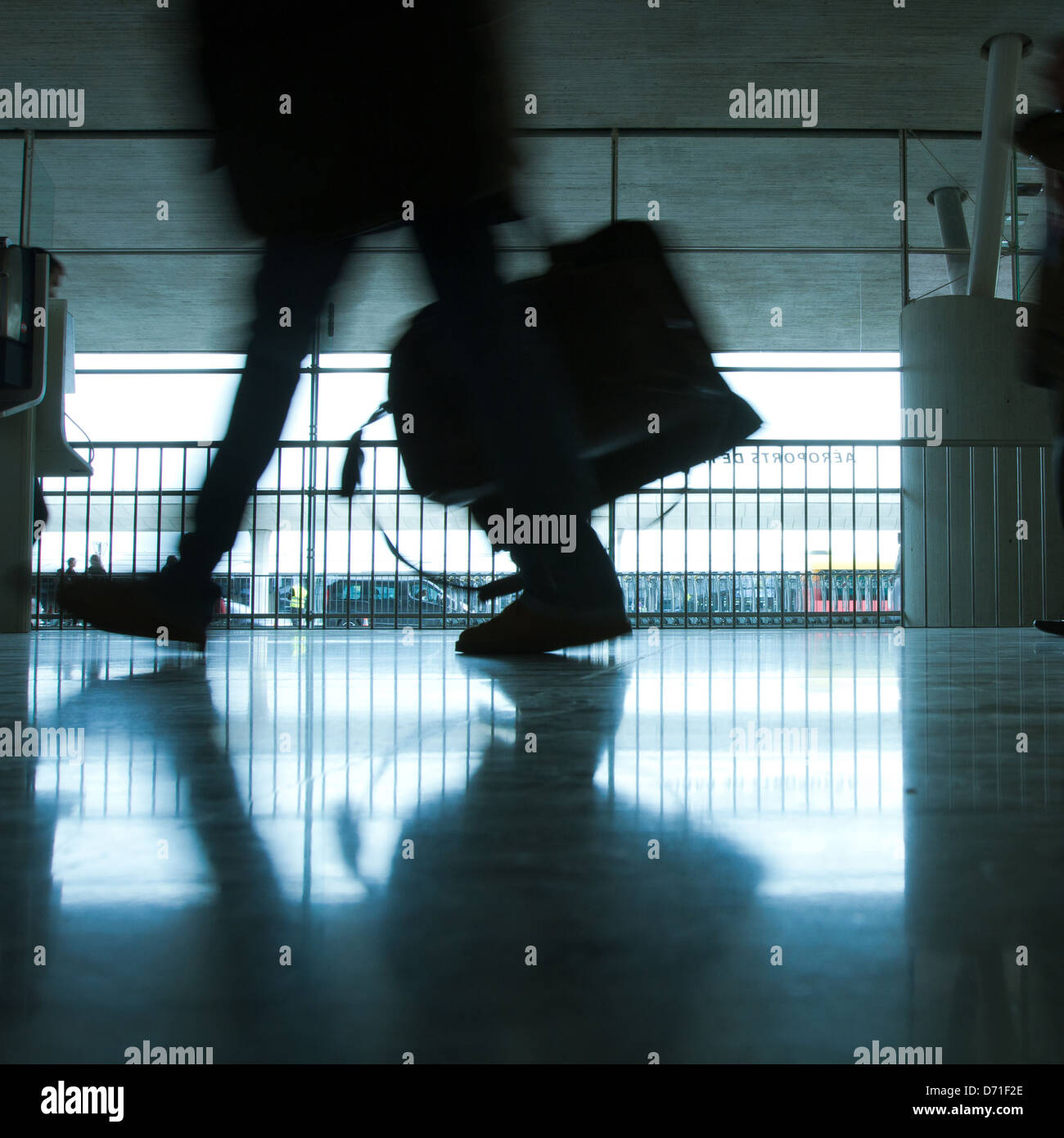 abstract airport and silhouette of walking person with luggage Stock Photo