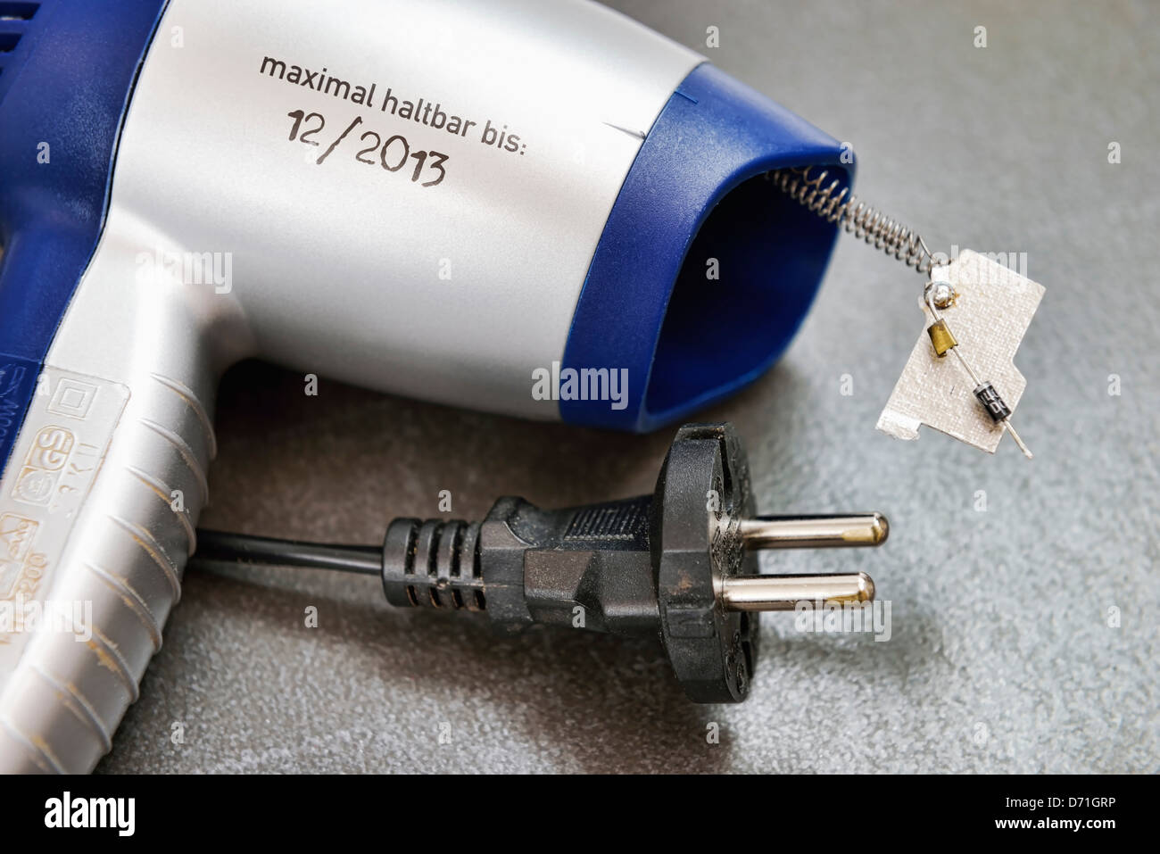 Hairdrier with built-in wearing part and durability date, symbolic photo - Stock Image
