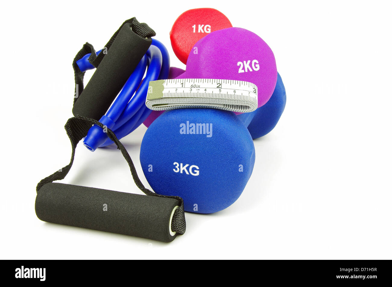 keep fit training equipment with a folded measuring tape on a white background - Stock Image