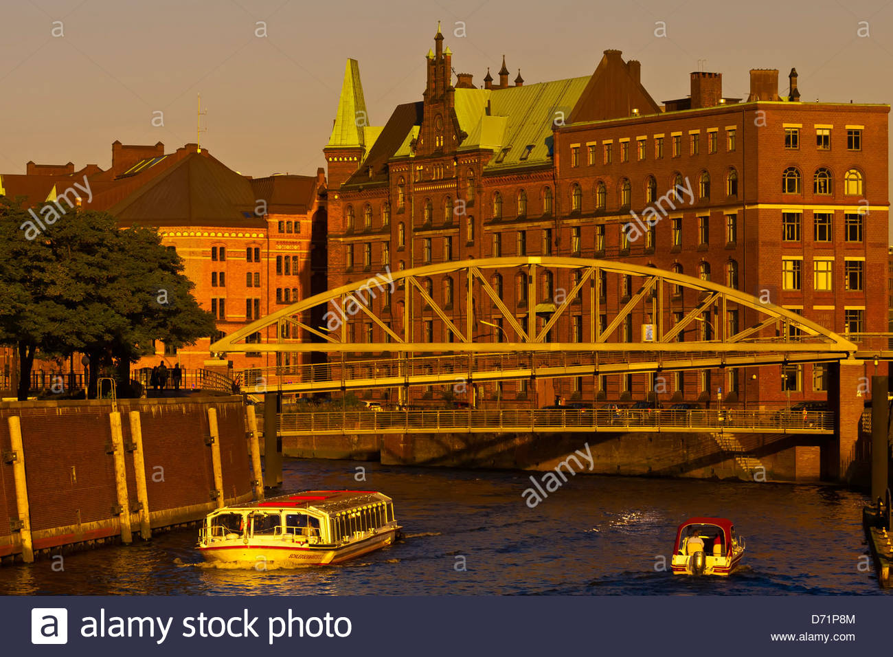 Canals in Speicherstadt (Warehouse District), Hafen City (along the harbor), Hamburg, Germany - Stock Image