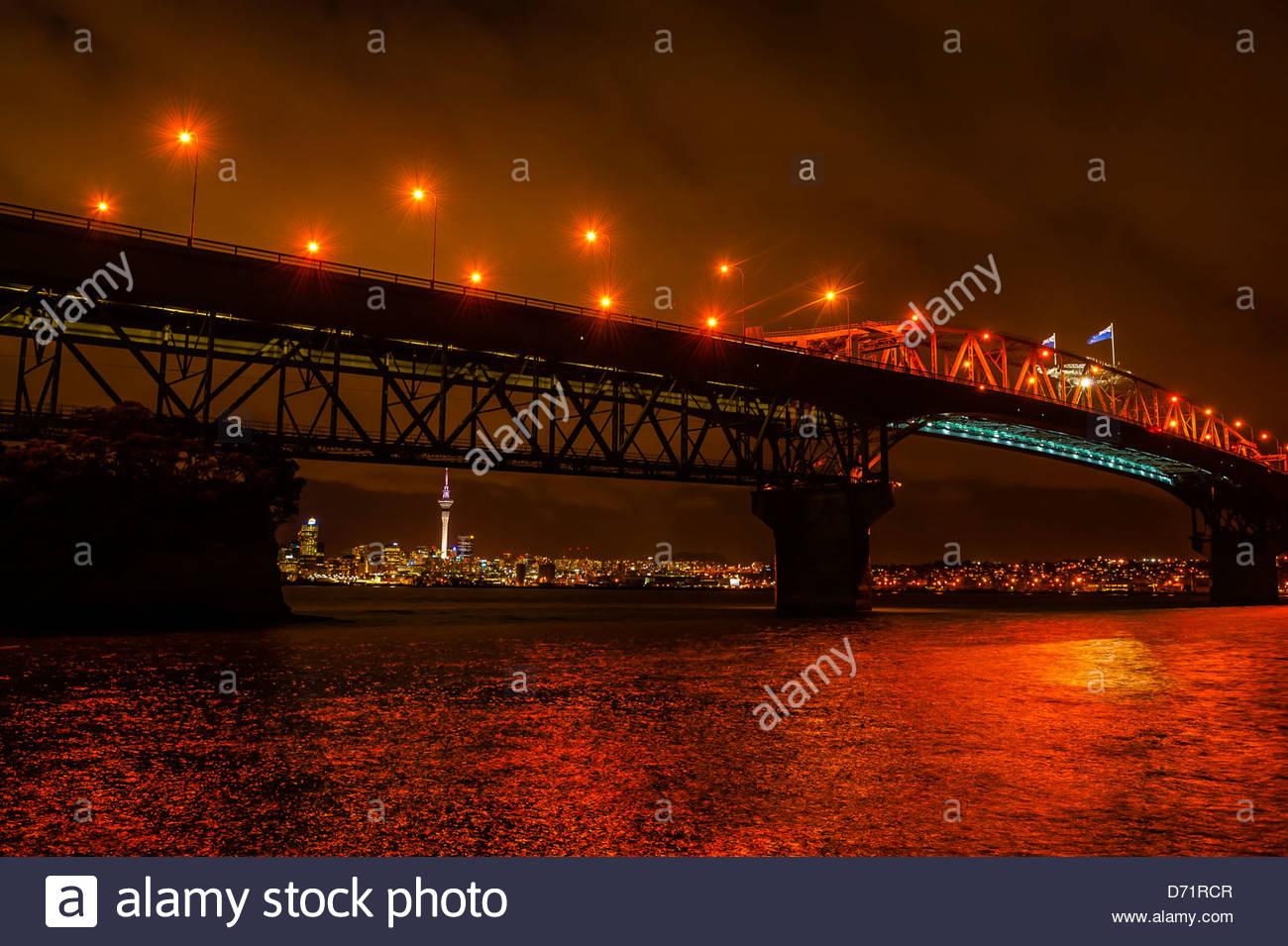 Auckland Harbour Bridge with the skyline of Auckland in background, Auckland, New Zealand - Stock Image