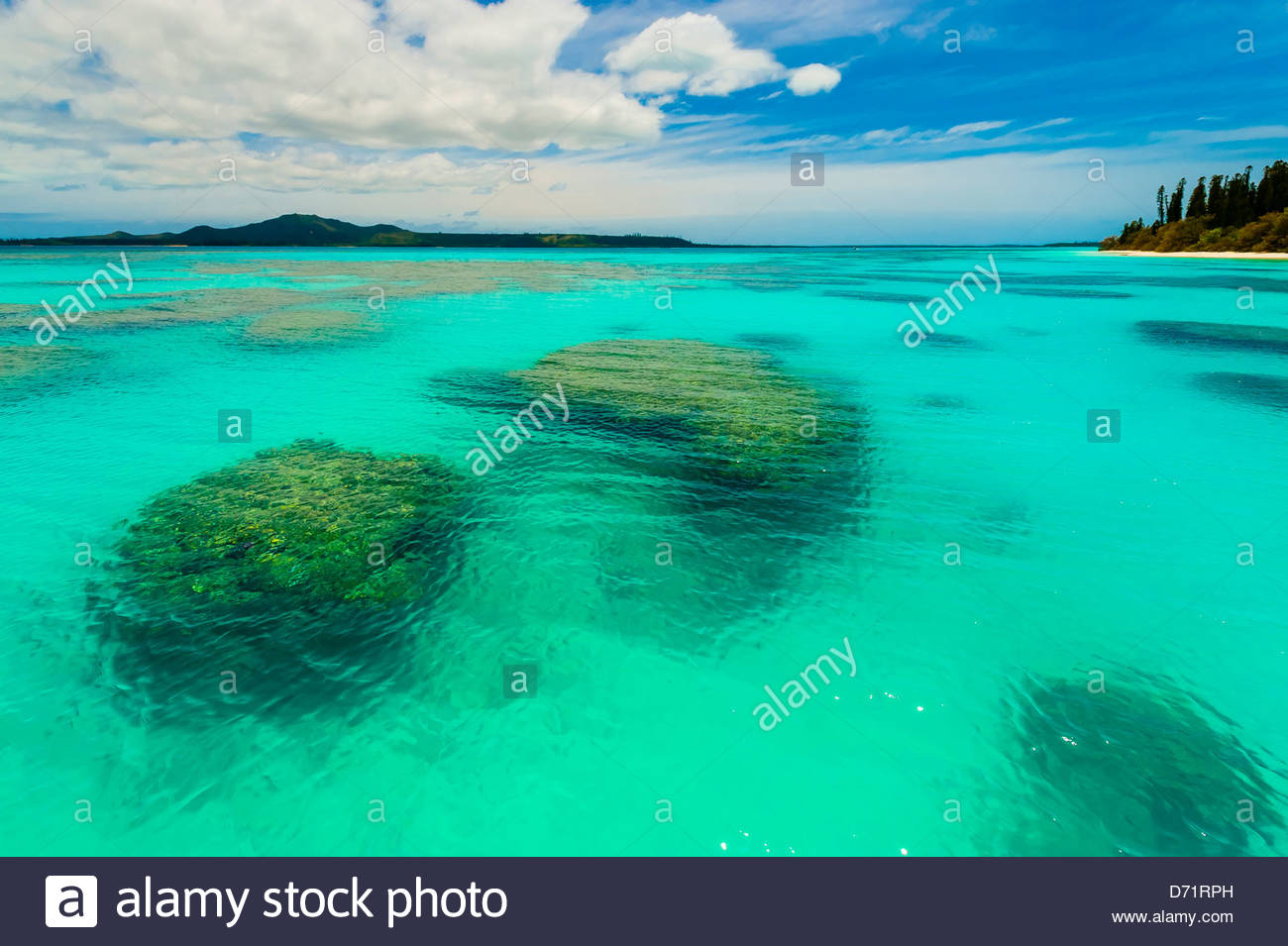 Coral reefs surrounding Brush Island, New Caledonia Barrier Reef off Ile des Pins (Isle of Pines), New Caledonia - Stock Image