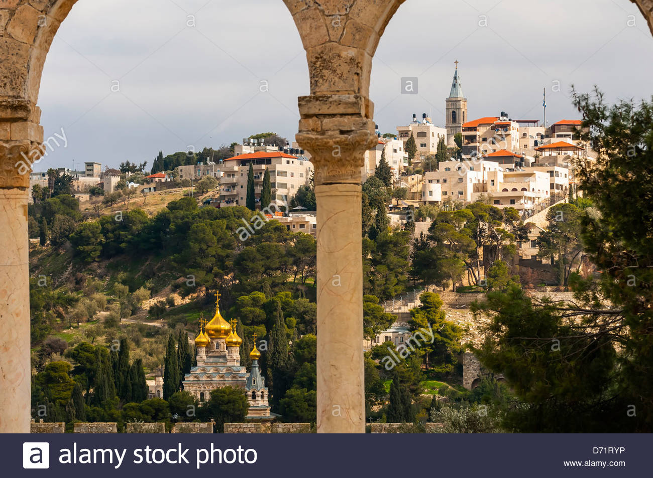 Russian Orthodox Church of Maria Magdelene, Mount of Olives, viewed through arches of the Dome of the Rock on the Stock Photo