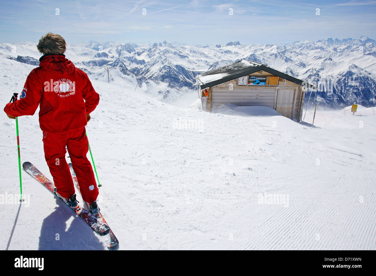 An ESF ecole de ski ski instructor observing the French Alps - Stock Image