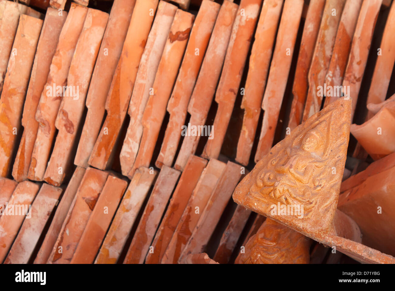 Detail of a red clay tile to repair a roof of temple in
