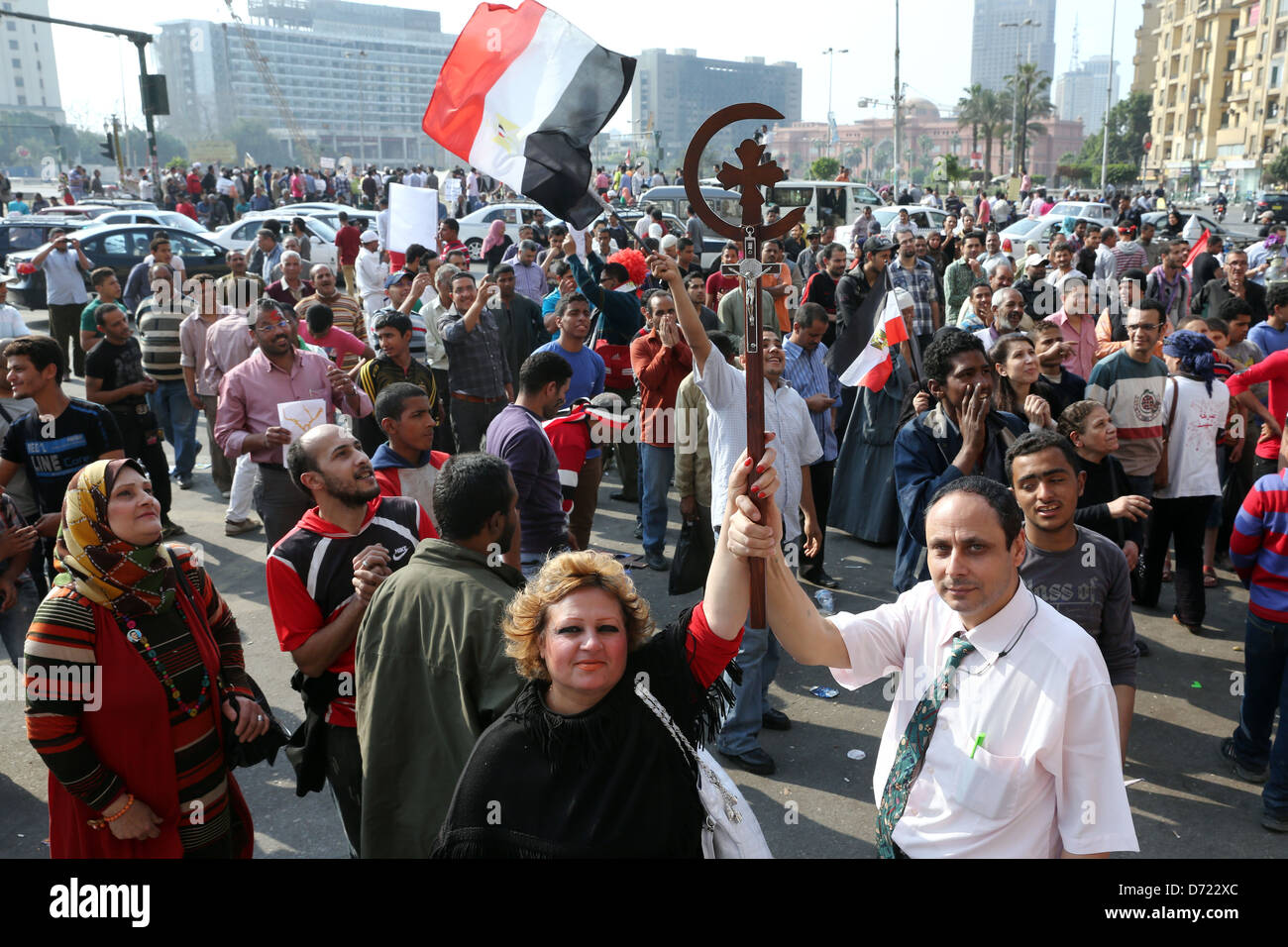 Egyptian christian couple hold a cross during a mass rally in Tahrir Square, Cairo, Egypt - Stock Image