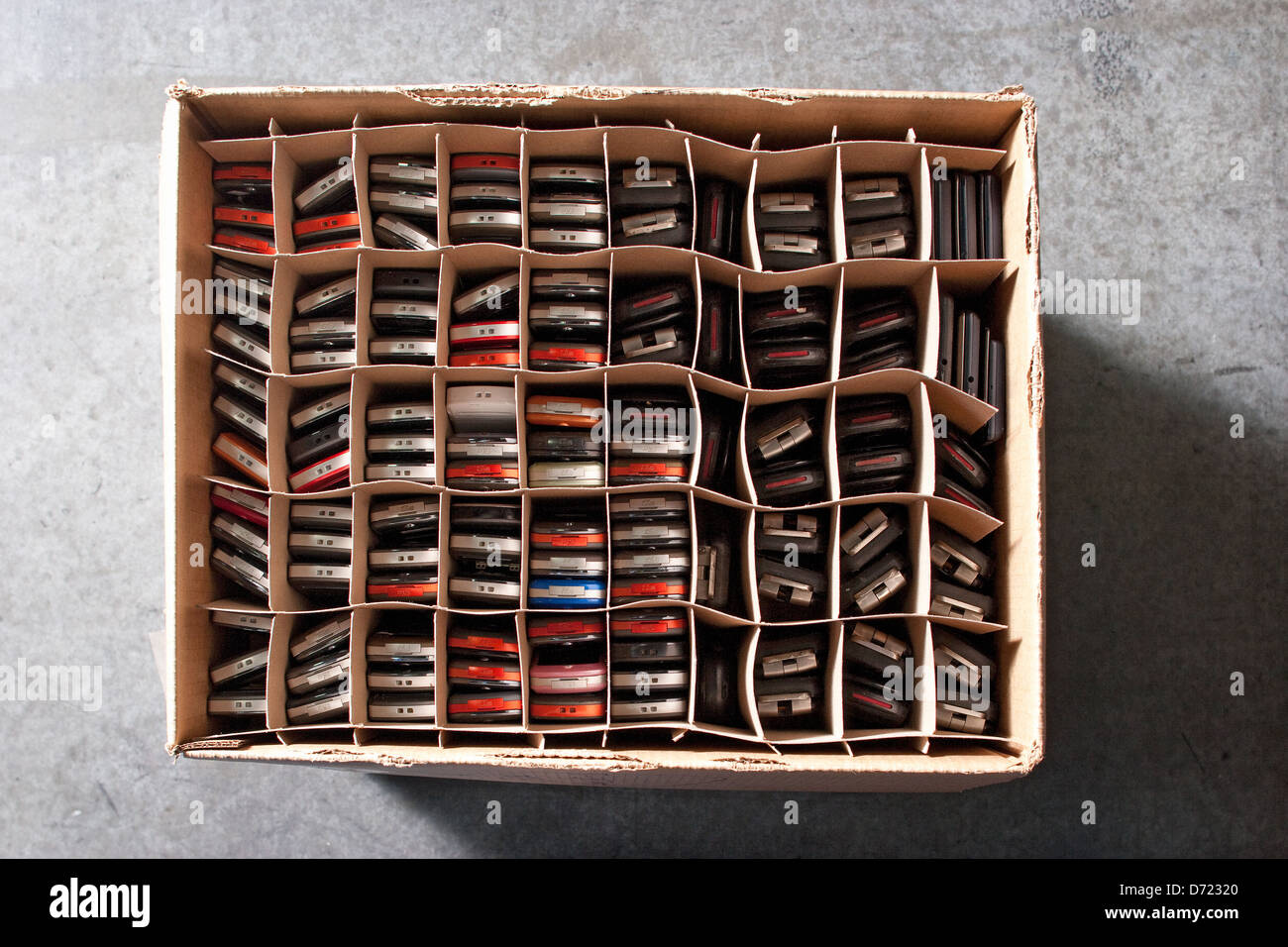 Box of recycled and refurbished cell phones packed and ready for shipping. - Stock Image