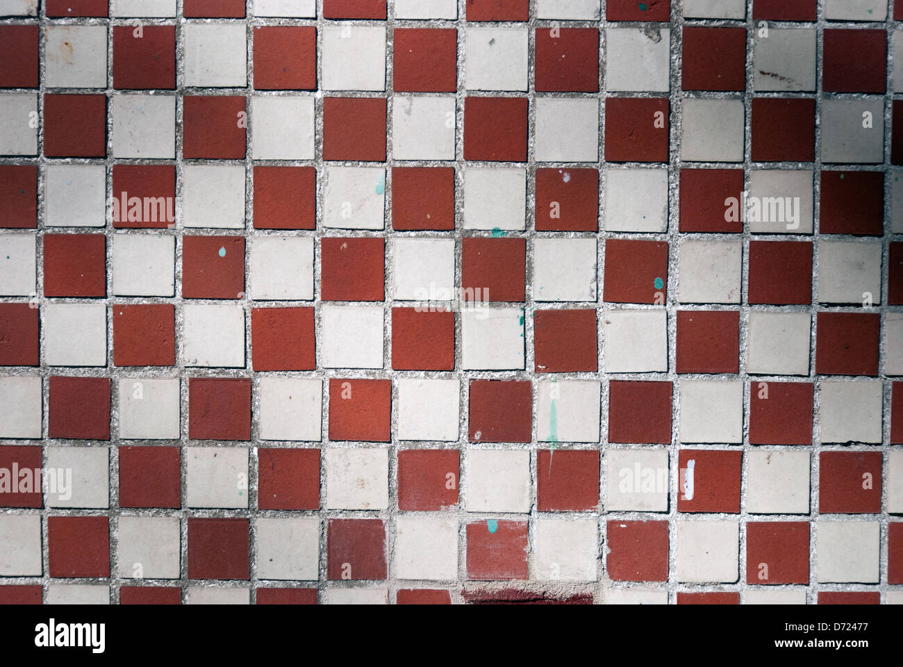 Close up of brown and white tiled floor - Stock Image