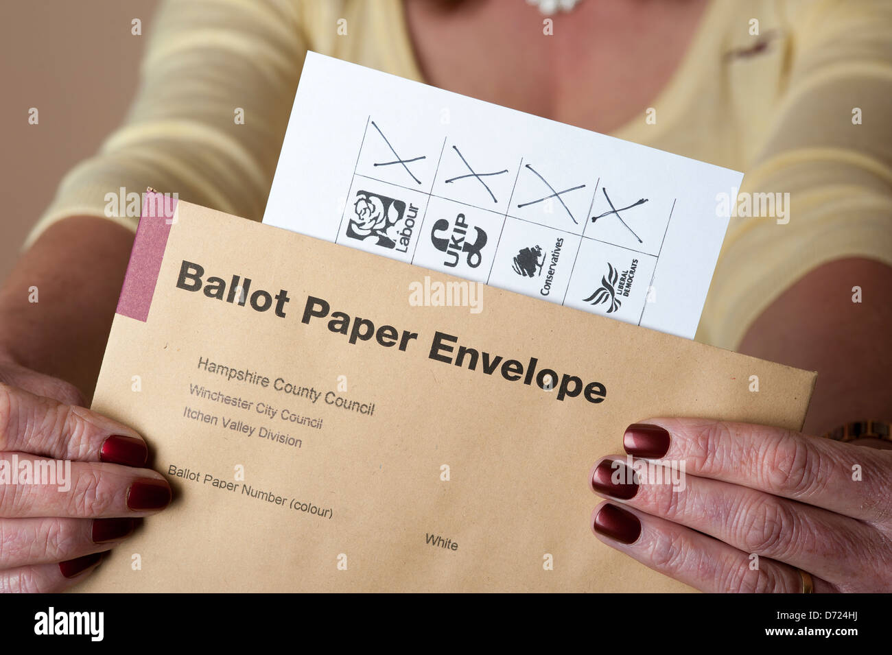 Spoiled voting paper where elector has marked a cross for each of four candidates - Stock Image