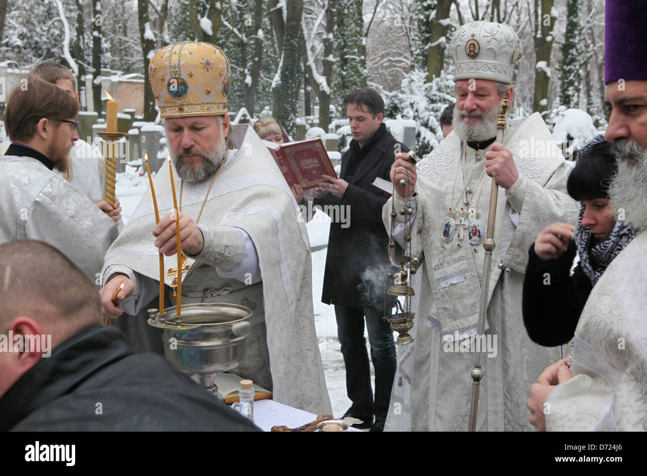 Orthodox Metropolitan Christopher consecrates Epiphany water in front of Dormition Church at the Olsany Cemetery - Stock Image